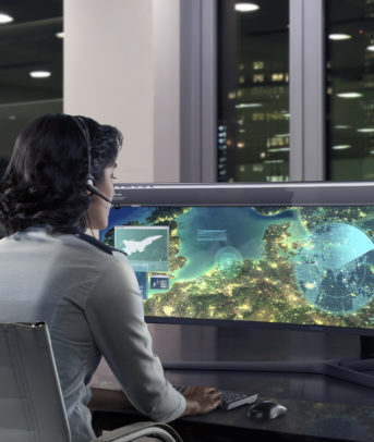 Government worker views a detailed map on a wide-screen monitor