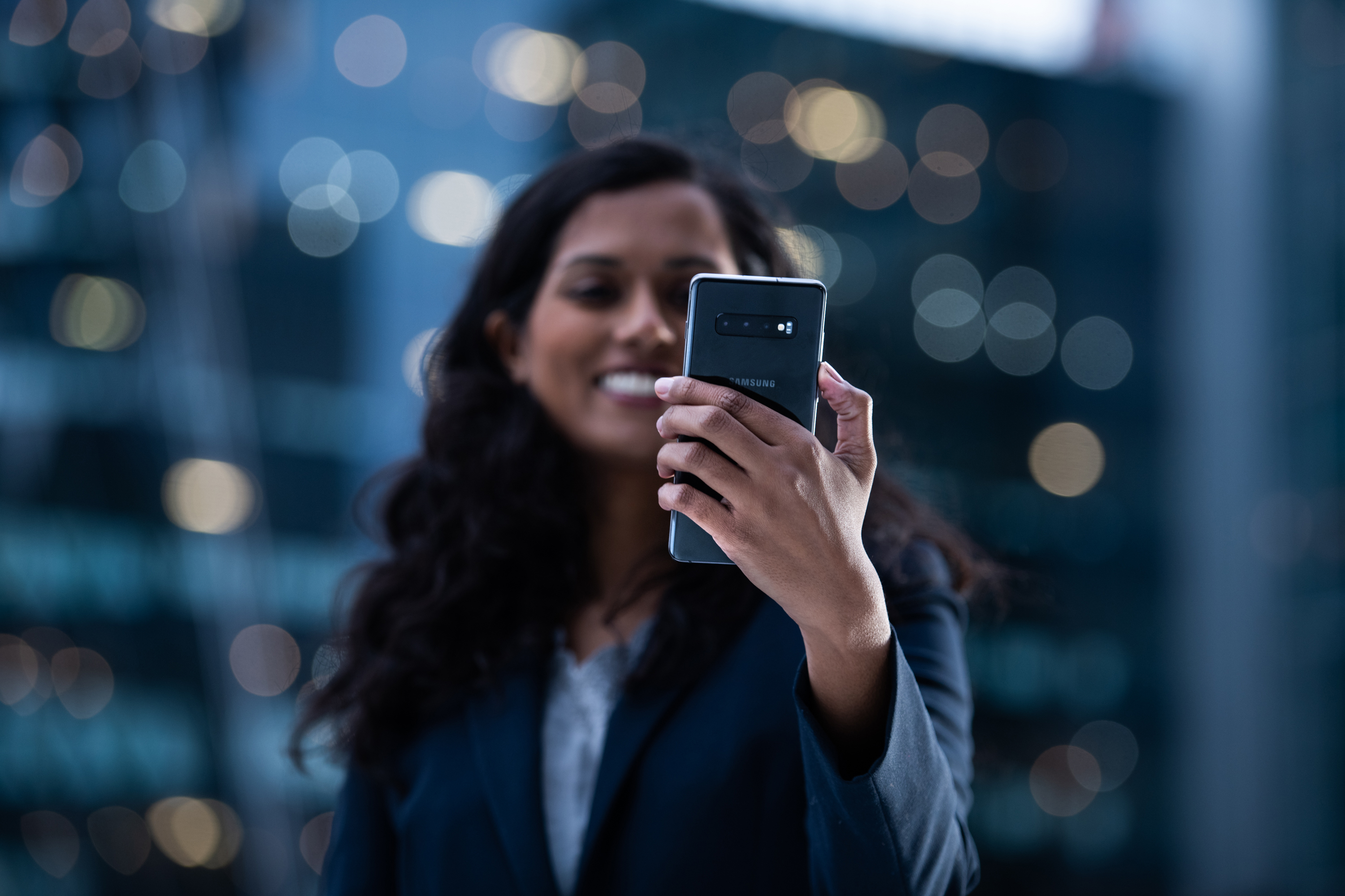 Woman holding Samsung Galaxy smartphone