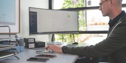 Remote worker at desk with various internet of things devices