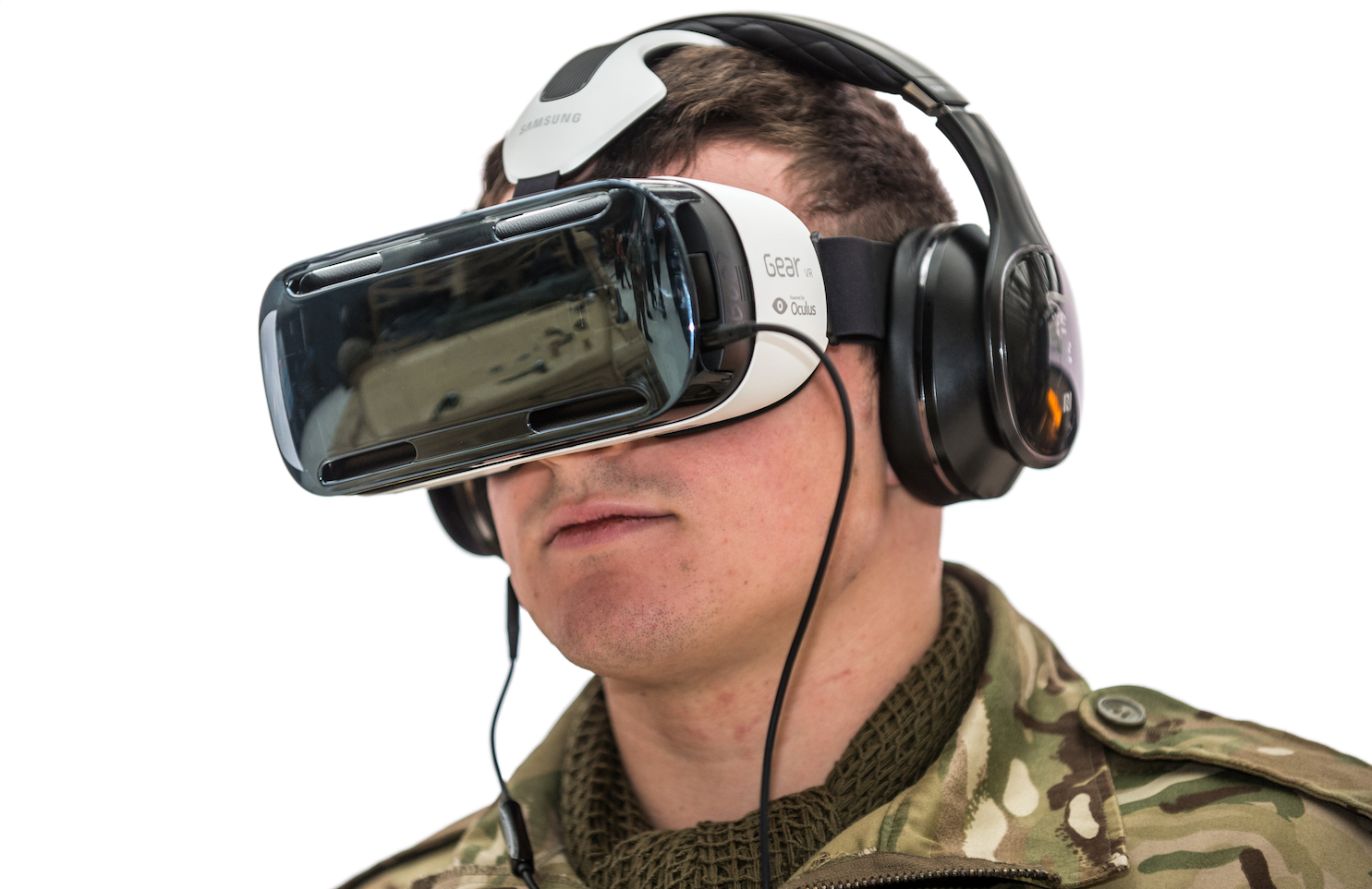 Solider wearing a VR headset and headphones for an immersive experience.