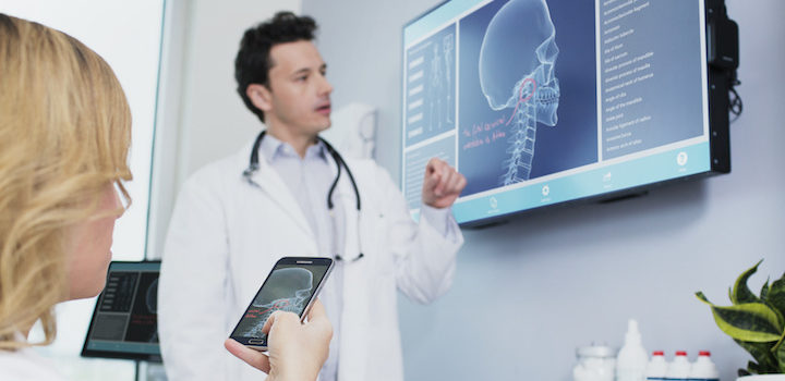 patient with tablet doctor with digital display