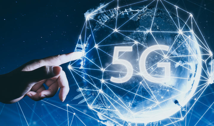 Hand touching global 5G network.