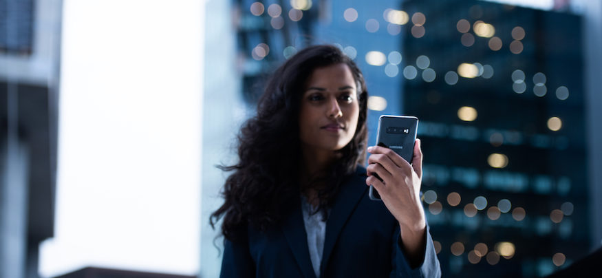 woman holding a Samsung S