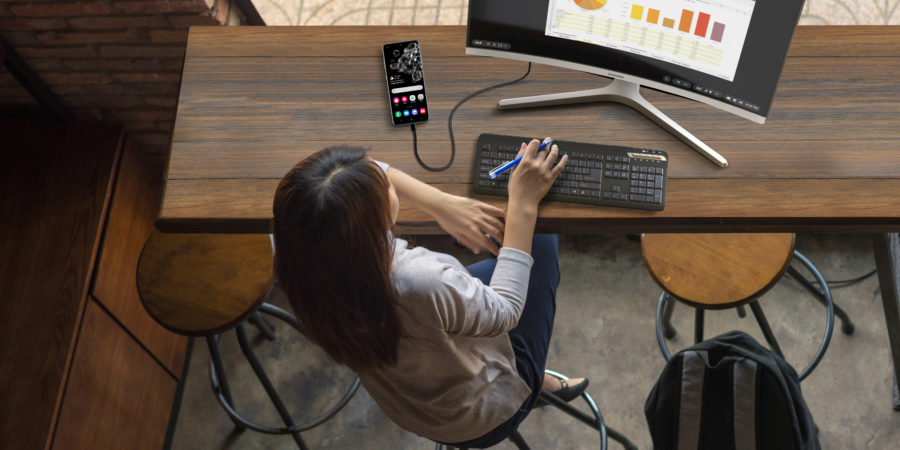 Woman using Samsung DeX on a monitor