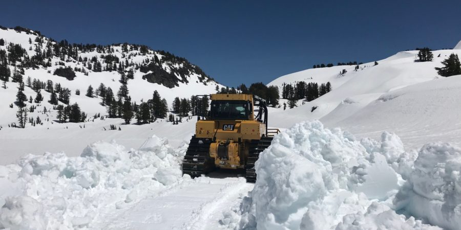 Bulldozer plowing snow in the national park