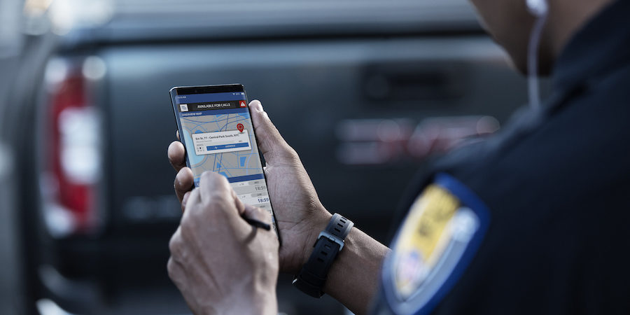A law enforcement officer using a smartphone for field work