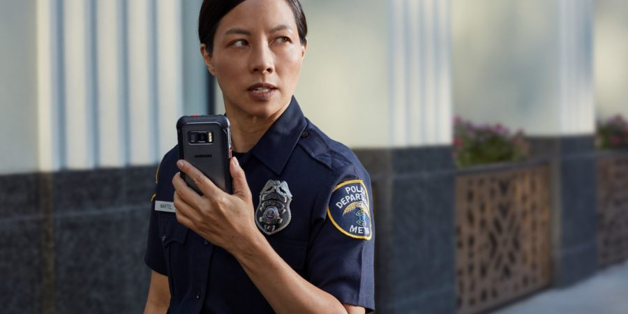 Police officer using XCover FieldPro for Push to Talk communications