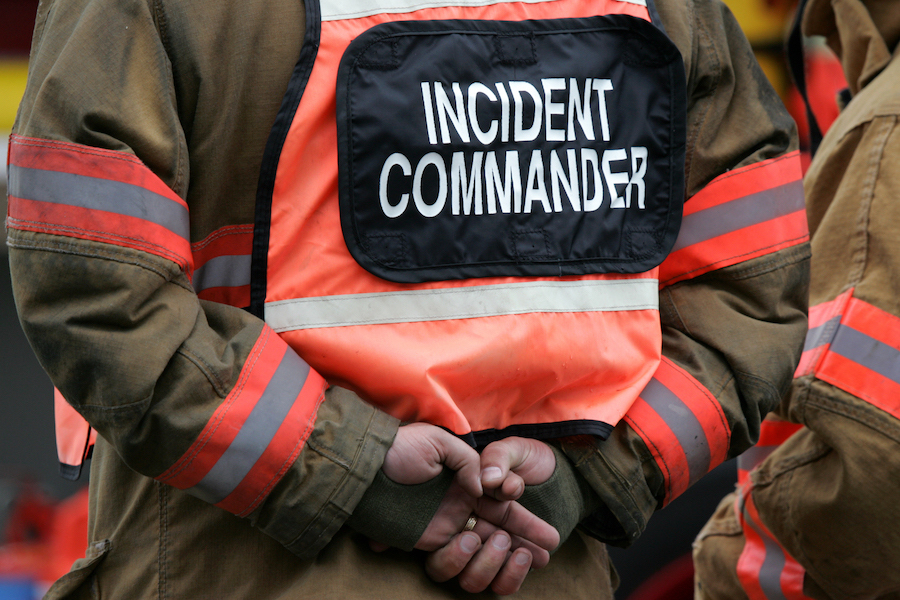 An incident commander in uniform on the job